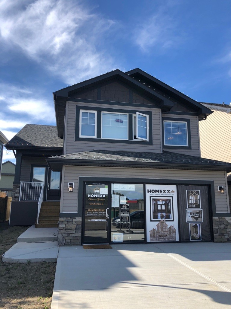 Single family front attached showhome by Homexx located in West Haven Park in Leduc