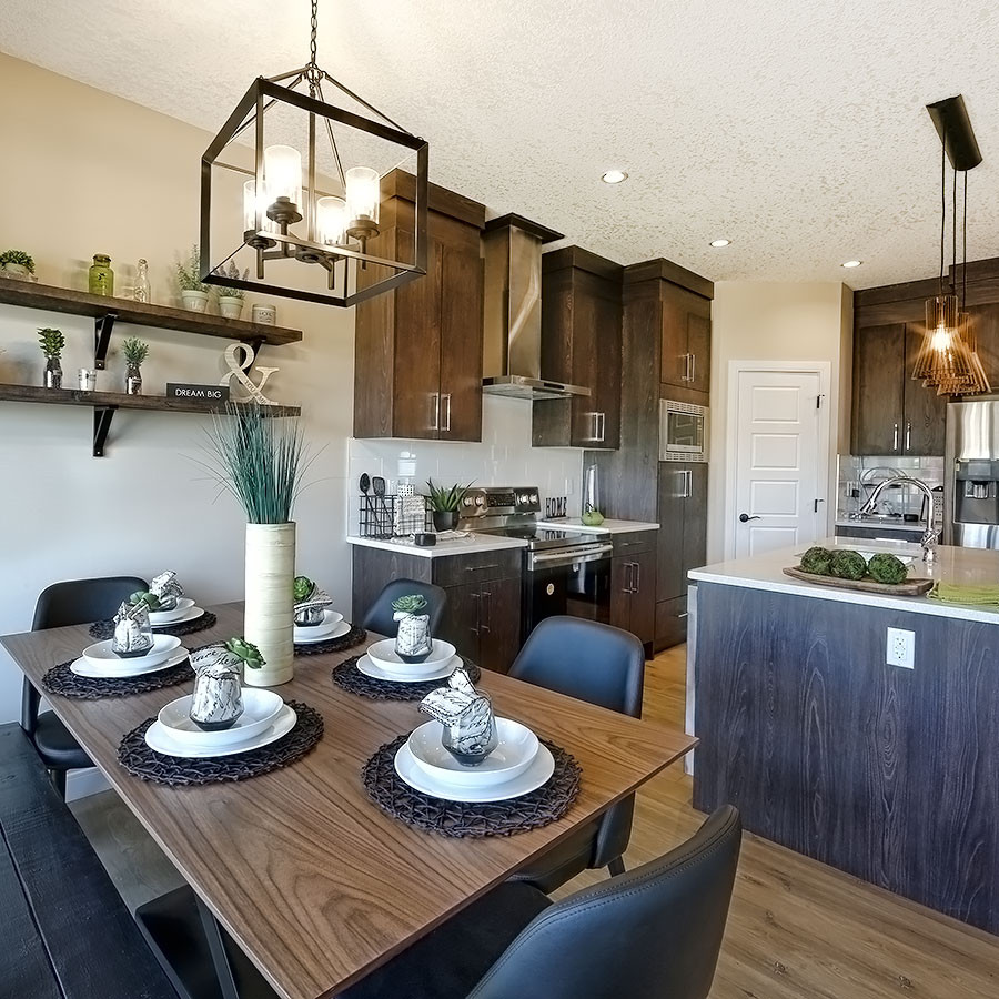 Image of dining and kitchen in the Areo Homes Mileena Duplex in West Haven Park