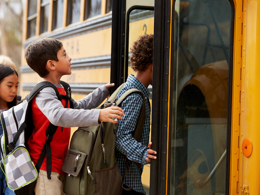 School children boarding the bus in West Haven Park, going to elementary school and junior high school West Haven Public School.